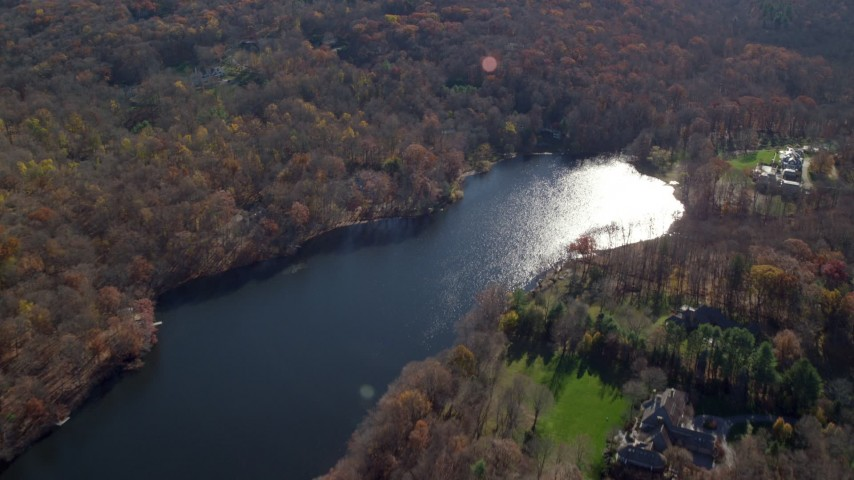 6K stock footage aerial video of lakeside mansion and homes in Autumn, Mt Kisco, New York Aerial Stock Footage | AX119_213