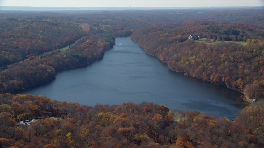 6K stock footage aerial video orbit reservoir in Autumn, Mt Kisco, New York Aerial Stock Footage | AX119_215