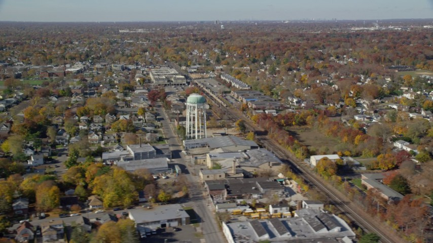 6K stock footage aerial video orbit industrial buildings and train tracks in Autumn, Farmingdale, New York Aerial Stock Footage | AX119_255