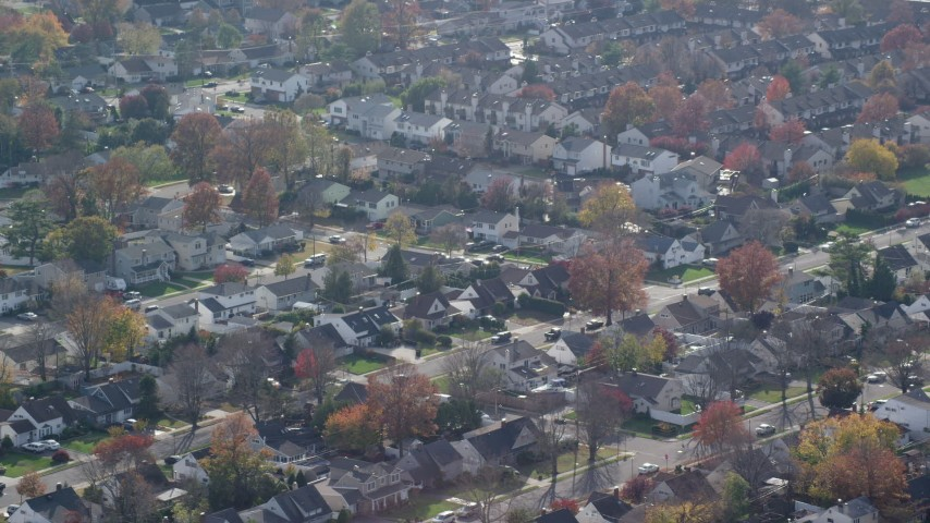6K stock footage aerial video of suburban homes in Autumn, Wantagh, New York Aerial Stock Footage | AX120_011