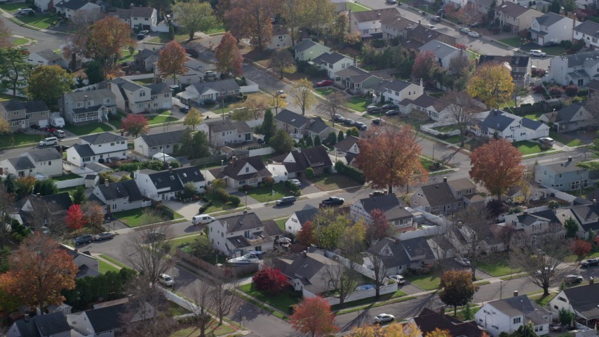 6K stock footage aerial video orbit quiet suburban neighborhoods in Autumn, Wantagh, New York Aerial Stock Footage | AX120_012