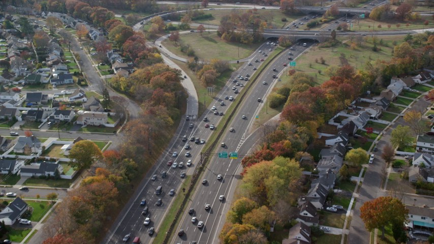 6K stock footage aerial video follow freeway with light traffic in Autumn, Wantagh, New York Aerial Stock Footage | AX120_013