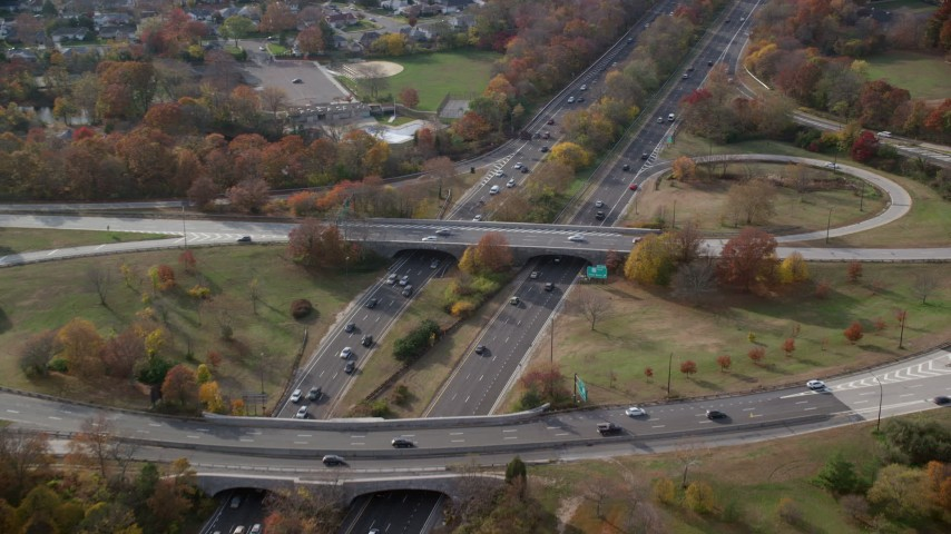 6K stock footage aerial video of a freeway interchange with light traffic in Autumn, Wantagh, New York Aerial Stock Footage | AX120_014