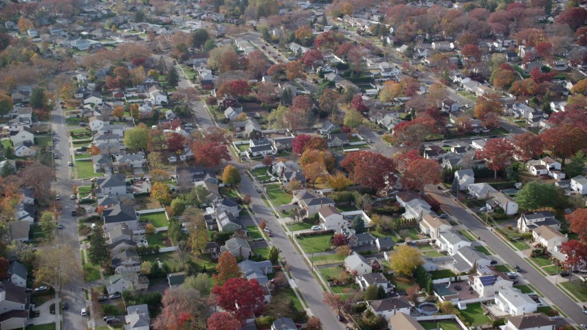 6K stock footage aerial video approach quiet suburban neighborhoods in  Autumn, North Bellmore, New York