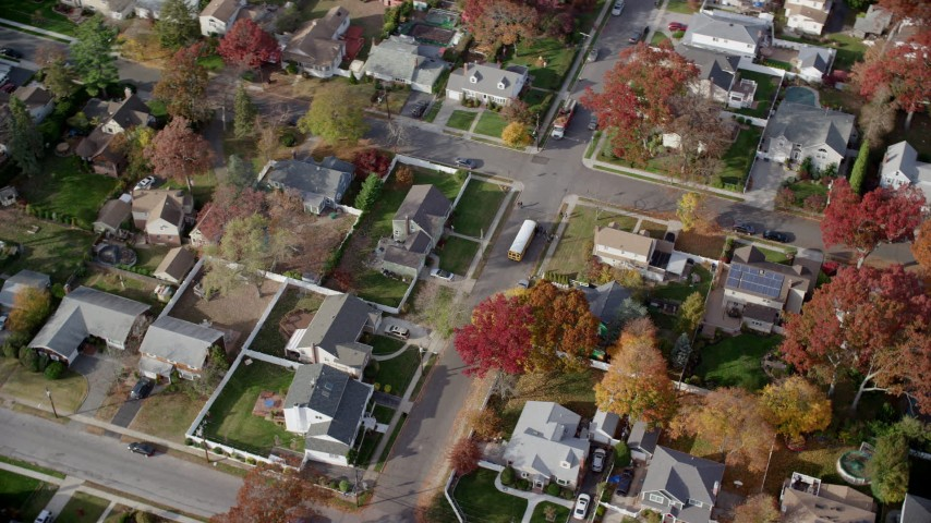 6K stock footage aerial video of a school bus in suburban neighborhood in  Autumn, North Bellmore, New York