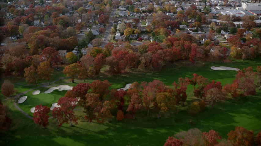6K stock footage aerial video fly over golf course and suburbs in Autumn, West Hempstead, New York Aerial Stock Footage | AX120_031