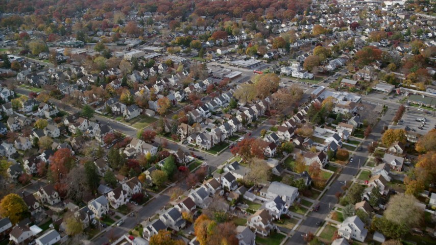 6K stock footage aerial video fly over suburban houses in Autumn, West Hempstead, New York Aerial Stock Footage | AX120_032