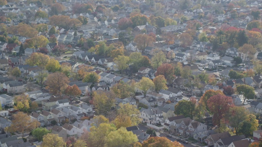 6K aerial video of suburban tract homes in Autumn, Queens Village, Queens, New York City Aerial Stock Footage | AX120_041