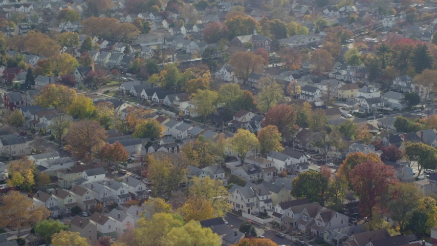 6K stock footage aerial video of suburban tract homes in Autumn, Queens Village, Queens, New York City Aerial Stock Footage | AX120_041E