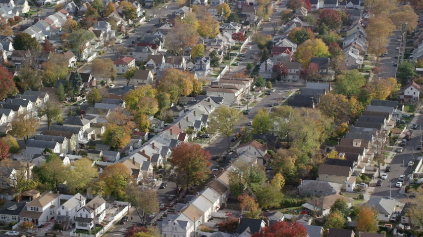 Suburban Tract Homes in Autumn, Queens Village, Queens, New York City Aerial Stock Footage | AX120_042