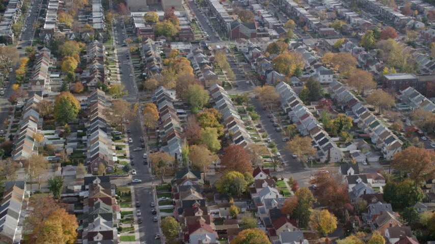 6K aerial video of orbiting suburban tract homes in Autumn, Queens Village, Queens, New York City Aerial Stock Footage | AX120_043