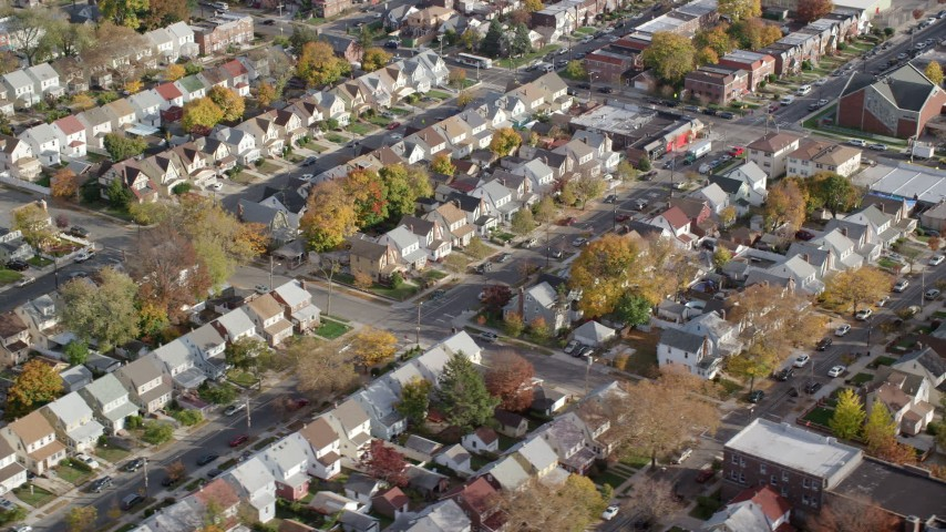 Suburban Tract Homes in Autumn, Queens Village, Queens, New York City Aerial Stock Footage | AX120_044