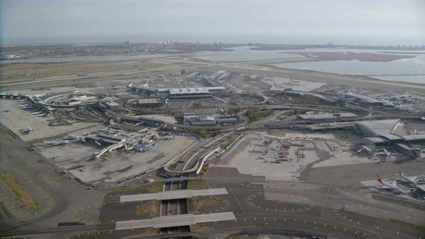 6K stock footage aerial video orbit John F. Kennedy International Airport, New York in Autumn Aerial Stock Footage | AX120_052