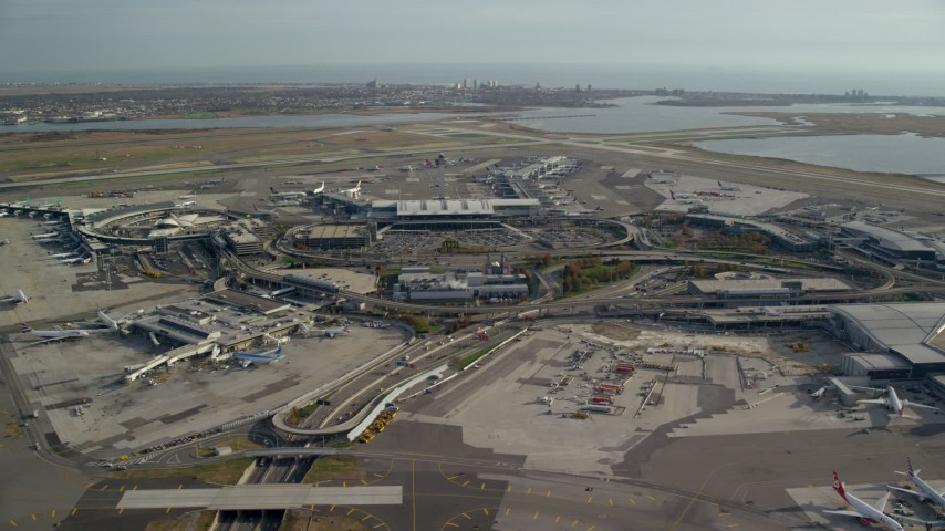 6K stock footage aerial video orbit John F. Kennedy International Airport, New York in Autumn Aerial Stock Footage | AX120_052E
