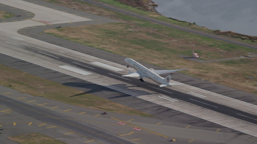 6K stock footage aerial video of an airliner taking off from JFK Airport, New York Aerial Stock Footage AX120_056 | Axiom Images