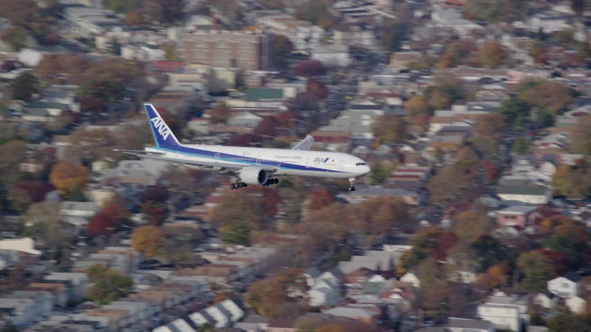 6K stock footage aerial video of a commercial jet approaching JFK Airport in Autumn Aerial Stock Footage | AX120_068