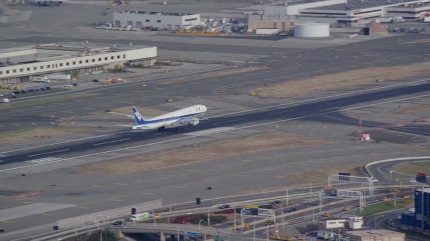 6K stock footage aerial video of a passenger jet landing at JFK Airport in New York Aerial Stock Footage | AX120_070