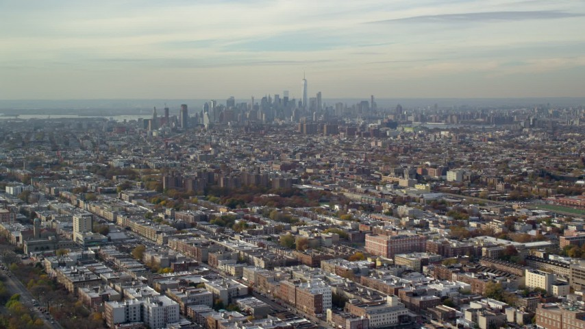 6K stock footage aerial video of Lower Manhattan skyline seen from Brooklyn in Autumn, New York City Aerial Stock Footage | AX120_080