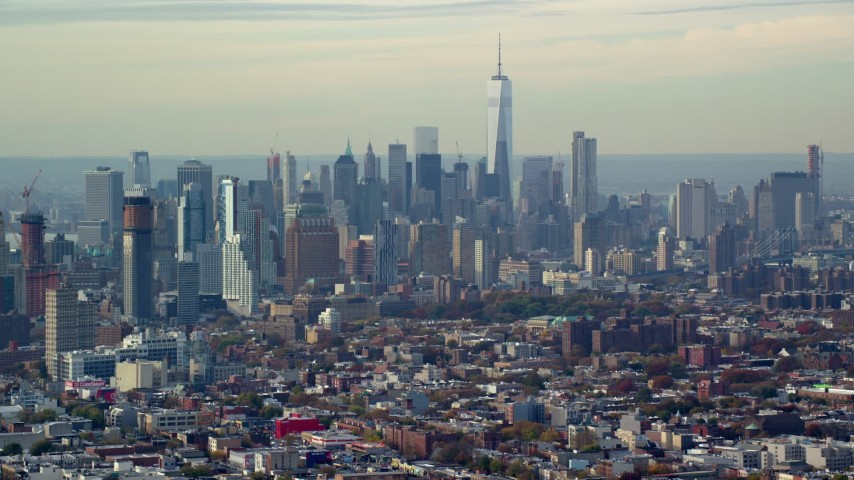 6K stock footage aerial video of Lower Manhattan's tall skyline seen from Brooklyn in Autumn, New York City Aerial Stock Footage | AX120_082