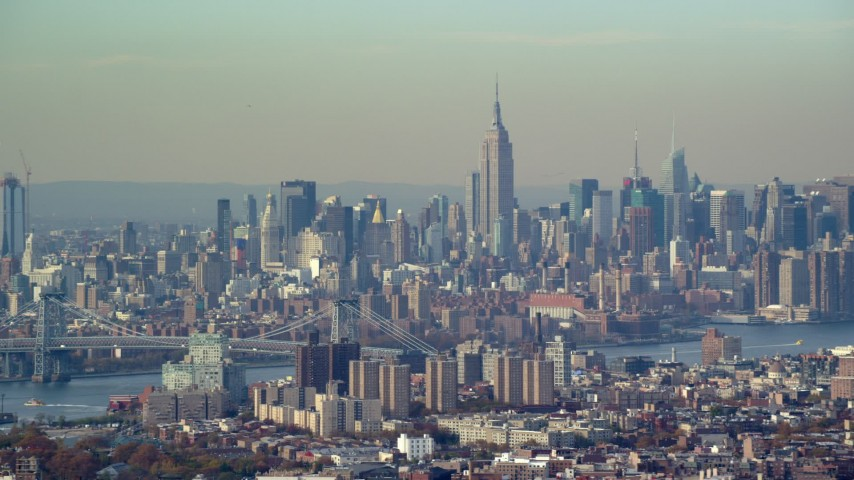 6K stock footage aerial video of the Midtown Manhattan skyline seen from Brooklyn in Autumn, New York City Aerial Stock Footage | AX120_083