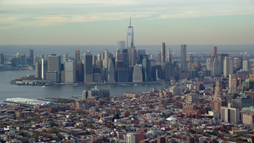 6K stock footage aerial video of the towering Lower Manhattan skyline seen from Brooklyn in Autumn, New York City Aerial Stock Footage | AX120_086