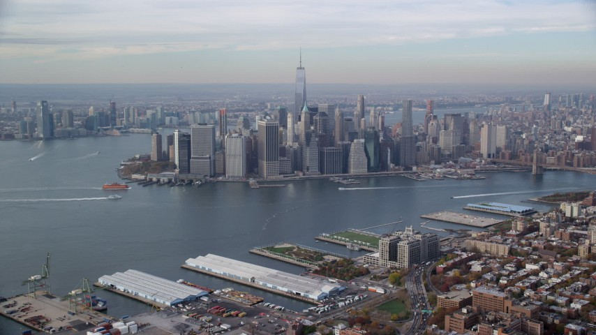 6K stock footage aerial video approach Lower Manhattan skyscrapers in Autumn, New York City Aerial Stock Footage | AX120_089