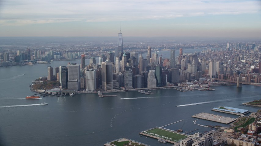 6K stock footage aerial video of an approach to Lower Manhattan skyscrapers in Autumn, New York City Aerial Stock Footage | AX120_090