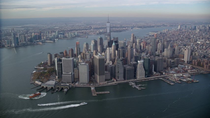 6K stock footage aerial video approach Lower Manhattan from the river in Autumn, New York City Aerial Stock Footage | AX120_092