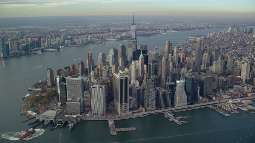 6K stock footage aerial video approach Lower Manhattan from the river in Autumn, New York City Aerial Stock Footage | AX120_092E