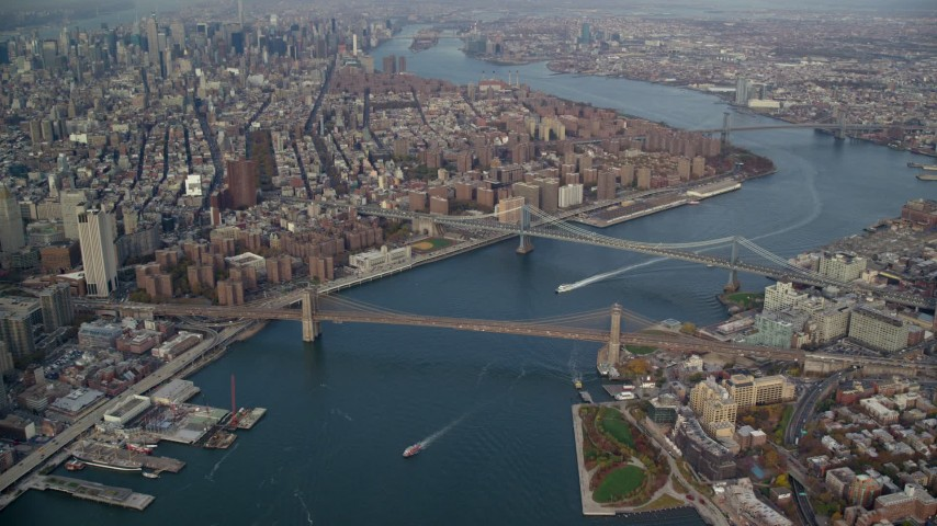 6K stock footage aerial video of a view of the Brooklyn and Manhattan Bridges in Autumn, New York City Aerial Stock Footage | AX120_094