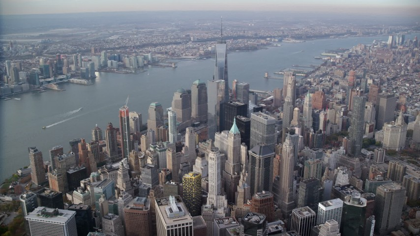 6K stock footage aerial video slowly fly over Lower Manhattan toward Freedom Tower, New York City Aerial Stock Footage | AX120_095