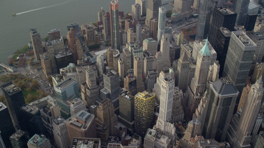 6K stock footage aerial video of looking down on Lower Manhattan skyscrapers in Autumn, New York City Aerial Stock Footage | AX120_097