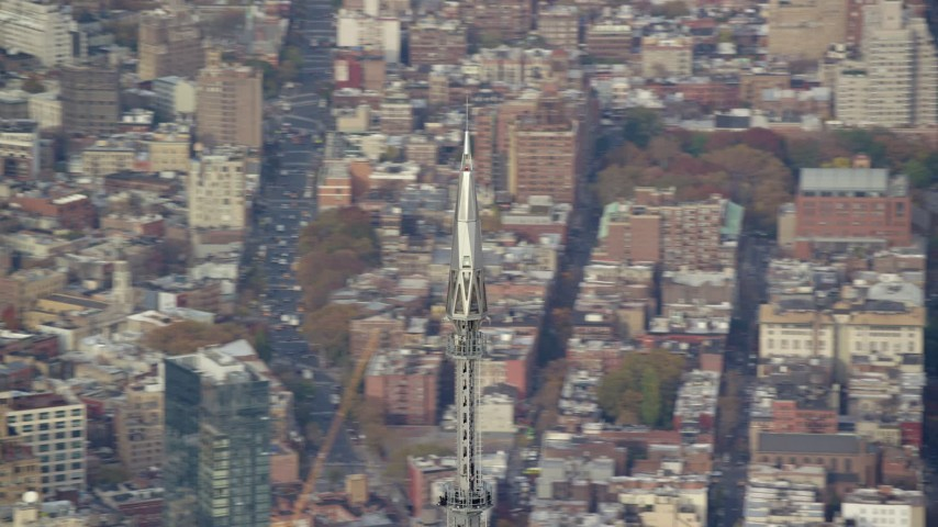 Top of One World Trade Center in Lower Manhattan, New York City Aerial Stock Footage | AX120_102