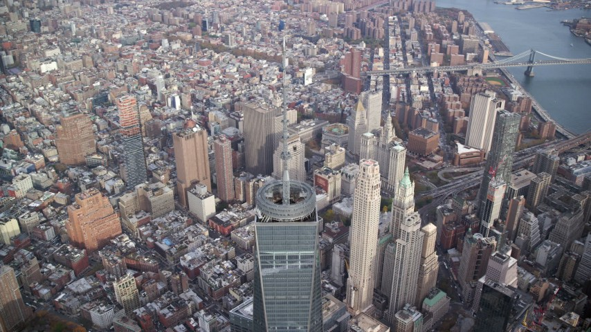 6K stock footage aerial video of orbiting around the spire of Freedom Tower in Lower Manhattan, New York City Aerial Stock Footage   AX120_103