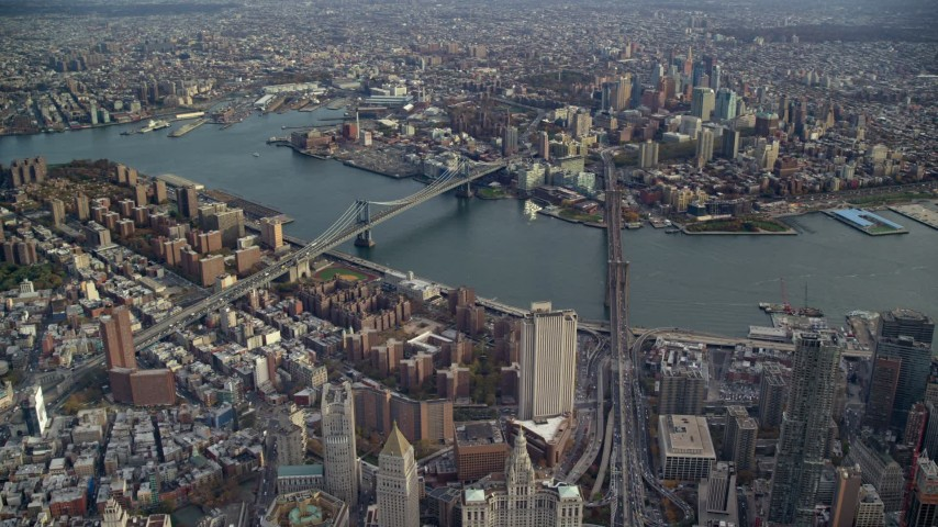 6K stock footage aerial video of a wide view of the Brooklyn Bridge and Manhattan Bridge in New York City Aerial Stock Footage | AX120_112E