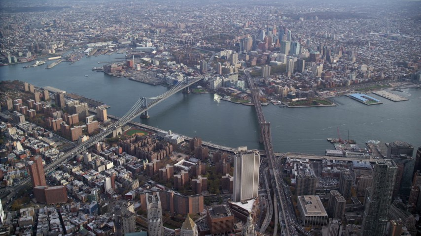 6K stock footage aerial video of an approach to the Brooklyn Bridge and Manhattan Bridge in New York City Aerial Stock Footage | AX120_113
