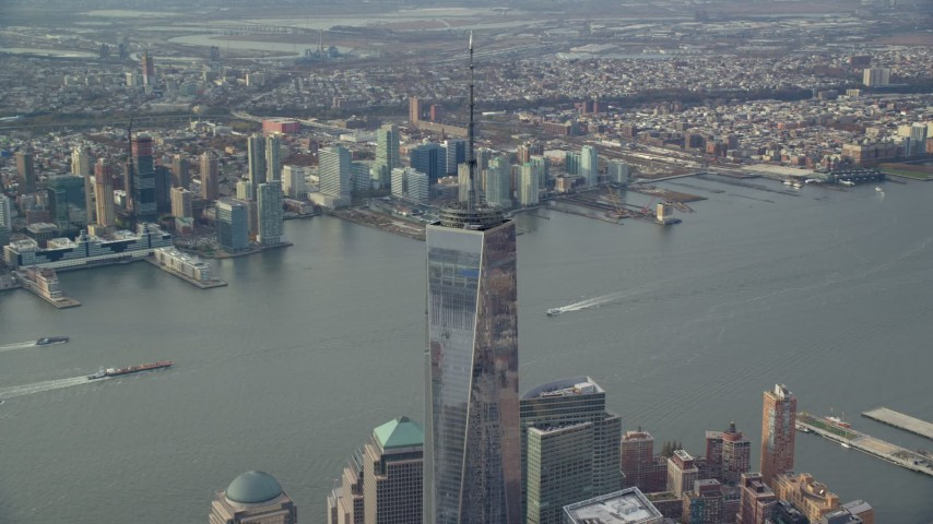 6K stock footage aerial video orbit One World Trade Center in Lower Manhattan, Jersey City in the background, New York City Aerial Stock Footage | AX120_116