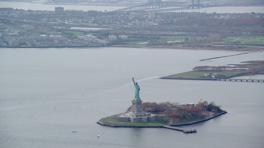 6K stock footage aerial video of a wide orbit of the Statue of Liberty in Autumn, New York Aerial Stock Footage | AX120_119