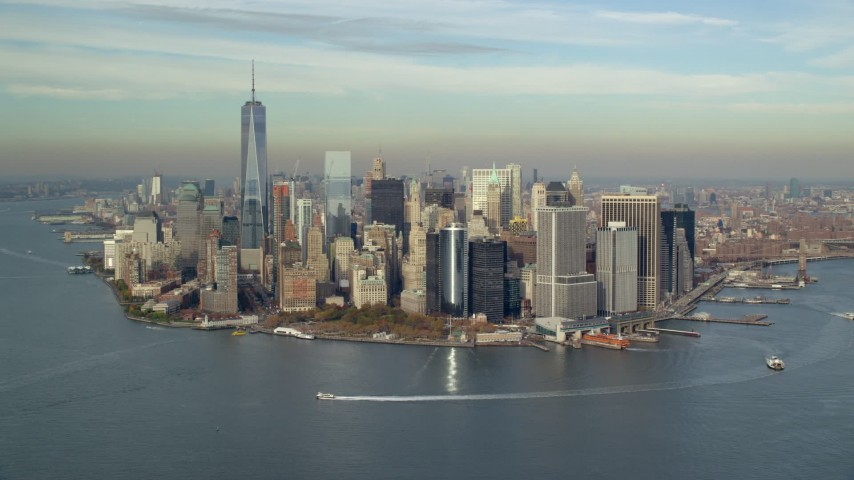 6K stock footage aerial video of approach Lower Manhattan and Battery Park in Autumn, New York City Aerial Stock Footage | AX120_121E