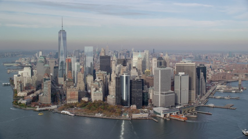 6K aerial video of an approach to Lower Manhattan and Battery Park in Autumn, New York City Aerial Stock Footage | AX120_122