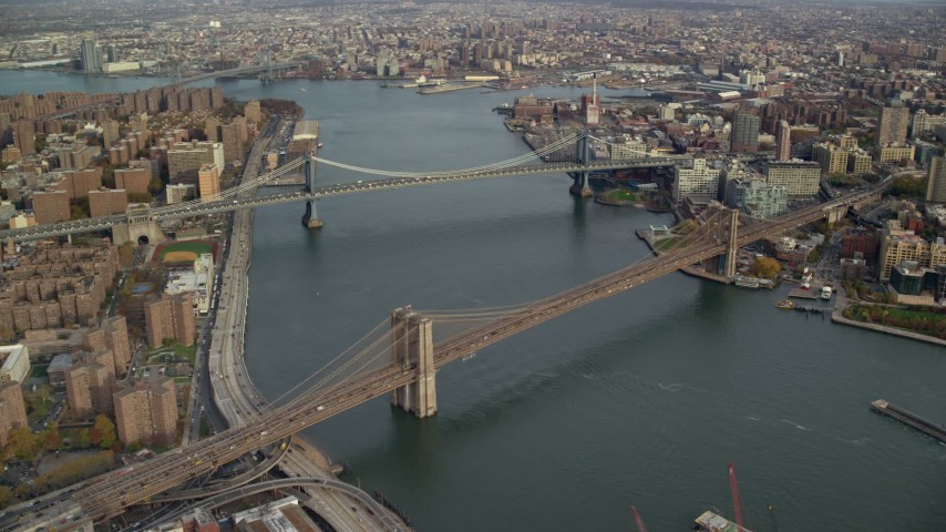 6K stock footage aerial video of approaching the Manhattan and Brooklyn Bridges in New York City Aerial Stock Footage | AX120_128