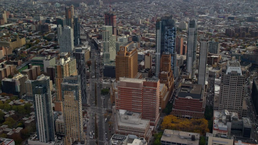 6K stock footage aerial video approach Brooklyn skyscrapers by Flatbush Ave in Autumn, New York City Aerial Stock Footage | AX120_132