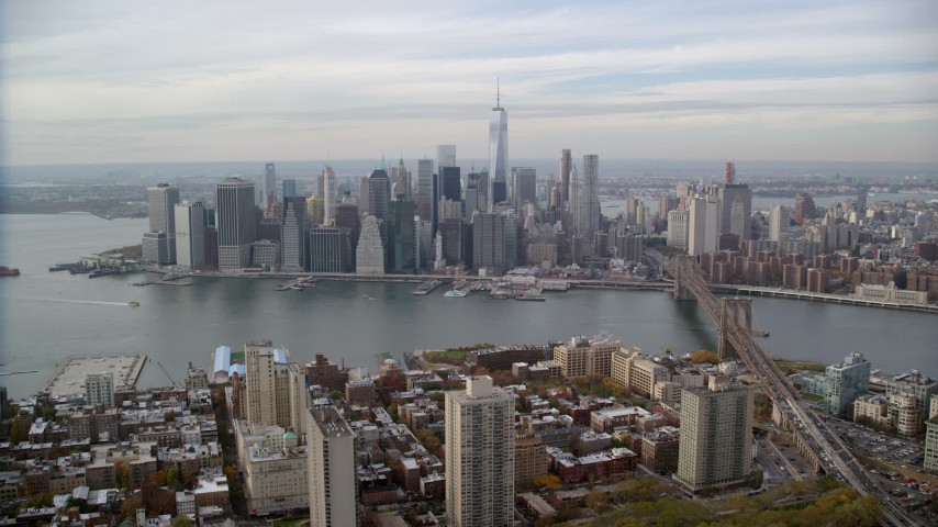 6K stock footage aerial video of an approach to the Lower Manhattan skyline from Brooklyn, New York City Aerial Stock Footage | AX120_133