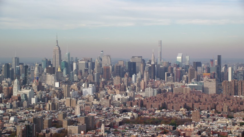 6K stock footage aerial video of skyscrapers in Midtown Manhattan in Autumn, New York City Aerial Stock Footage   AX120_137