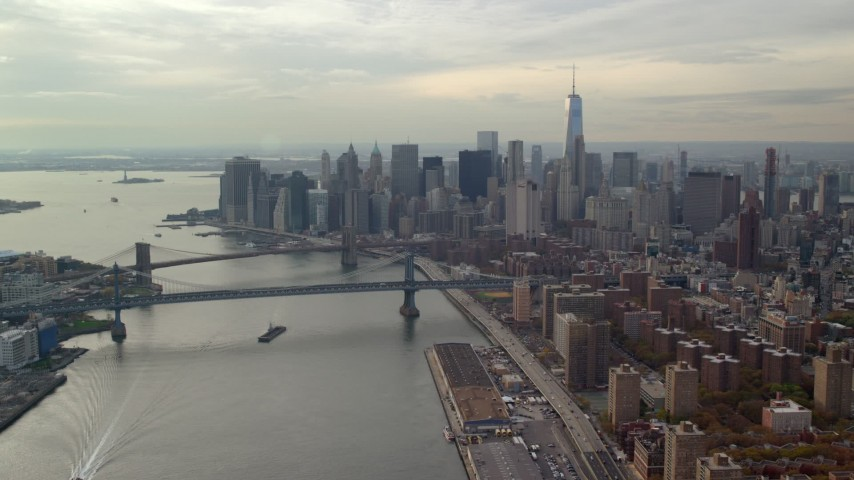 6K stock footage aerial video approach Brooklyn and Manhattan Bridges and Lower Manhattan from East River, New York City Aerial Stock Footage | AX120_140E
