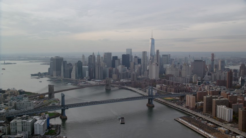 6K stock footage aerial video of Lower Manhattan skyscrapers by the Brooklyn and Manhattan Bridges, New York City Aerial Stock Footage | AX120_142