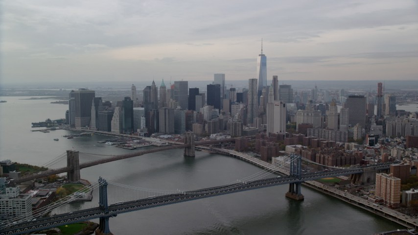 6K stock footage aerial video approach Manhattan Bridge, Brooklyn Bridges and Downtown, Lower Manhattan, New York City Aerial Stock Footage | AX120_143