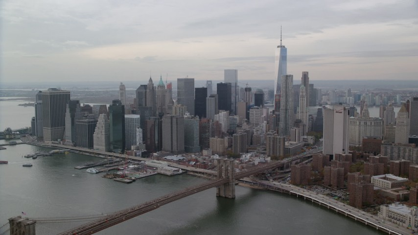 6K stock footage aerial video approach Brooklyn Bridge and Lower Manhattan skyline, New York City Aerial Stock Footage | AX120_145