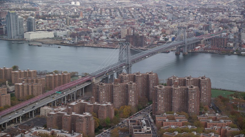 6K stock footage aerial video approach the Williamsburg Bridge in Autumn, New York City Aerial Stock Footage | AX120_151