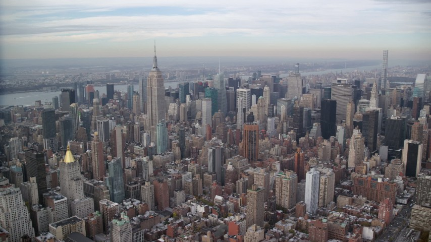 6K stock footage aerial video of approaching skyscrapers and Empire State Building in Midtown, New York City Aerial Stock Footage | AX120_157